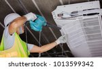 air conditioning technician and ... | Shutterstock . vector #1013599342