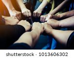 group of people joining their... | Shutterstock . vector #1013606302