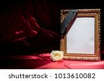 Small photo of Blank mourning frame on deep red perianth with white rose