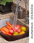 Fruits and veggies in a modern kitchen - stock photo