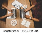 top view two man are working on ... | Shutterstock . vector #1013645005