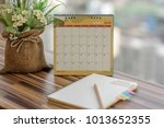 notebook with pencil diary on... | Shutterstock . vector #1013652355