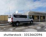 georgetown  bahamas a white van ... | Shutterstock . vector #1013662096