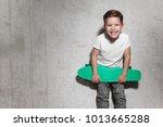 attractive little boy with... | Shutterstock . vector #1013665288