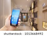 smart home system on smart phone | Shutterstock . vector #1013668492