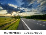 empty asphalt road in the... | Shutterstock . vector #1013678908