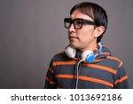 studio shot of young asian nerd ...   Shutterstock . vector #1013692186