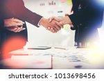 business people shaking hands... | Shutterstock . vector #1013698456