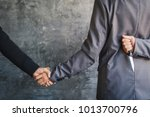 Small photo of Businessman shake hand and betray , selective of focus and blue background