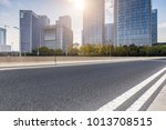 empty road with modern business ... | Shutterstock . vector #1013708515