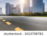 empty road with modern business ... | Shutterstock . vector #1013708782