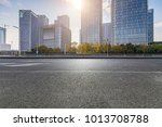 empty road with modern business ... | Shutterstock . vector #1013708788