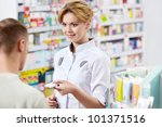 The pharmacist and the customer at the pharmacy - stock photo