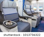 cup of coffee in aircraft empty ... | Shutterstock . vector #1013736322