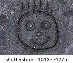 handwritten cute baby face on...   Shutterstock . vector #1013774275