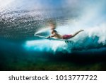 young surfer dives under the... | Shutterstock . vector #1013777722