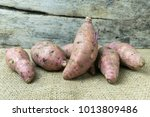 Small photo of yam on wooden table