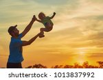 father playing with his son at... | Shutterstock . vector #1013837992
