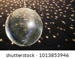 disco ball hanging on the wall | Shutterstock . vector #1013853946