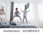 happy kids playing in white... | Shutterstock . vector #1013854315
