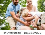 family with soccer ball argue... | Shutterstock . vector #1013869072