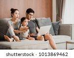happy parents with daughter...   Shutterstock . vector #1013869462
