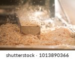 process of sawing a board with... | Shutterstock . vector #1013890366