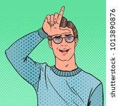 pop art portrait of man showing ... | Shutterstock .eps vector #1013890876