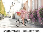 pretty young woman is riding on ... | Shutterstock . vector #1013894206