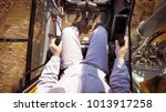 The driver view, control panel of a modern bulldozer or excavator or Loader, a man in Heavy equipment machinery tractor Construction duty vehicle command cabin. - stock photo