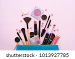 a blue cosmetics bag with... | Shutterstock . vector #1013927785