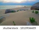coast of the sea at sunset. on... | Shutterstock . vector #1013936605