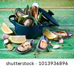 fresh boiled green mussels with ... | Shutterstock . vector #1013936896