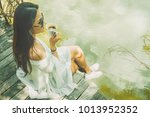 lifestyle traveler asian woman... | Shutterstock . vector #1013952352