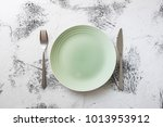 green round plate with utensils ... | Shutterstock . vector #1013953912