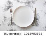 white round plate with utensils ... | Shutterstock . vector #1013953936