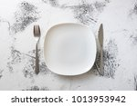 white round plate with utensils ... | Shutterstock . vector #1013953942