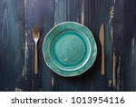 turquoise round plate with... | Shutterstock . vector #1013954116