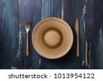 round plate with utensils on... | Shutterstock . vector #1013954122