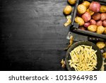 sliced potatoes in an old... | Shutterstock . vector #1013964985