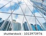 reflection of urban skyline on... | Shutterstock . vector #1013973976