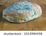 mold on bread. best before date ... | Shutterstock . vector #1013984458