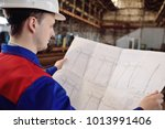 working engineer in a white... | Shutterstock . vector #1013991406