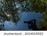 photographer silhouette  water... | Shutterstock . vector #1014015052