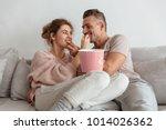happy loving couple sitting on... | Shutterstock . vector #1014026362