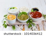 selection of different sauces... | Shutterstock . vector #1014036412