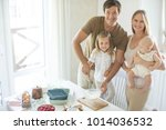 the family cooks in the kitchen  | Shutterstock . vector #1014036532