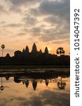 Small photo of Sunrise at Angkor Wat can be inexplicably captivating. And when the soft early sun is just abut peeping from behind The Pinnacle of the Holy Temple, it is a masterpiece.