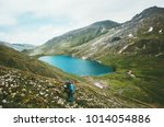 man with backpack hiking to... | Shutterstock . vector #1014054886