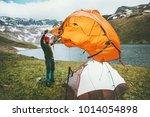 man traveler pitch tent camping ...   Shutterstock . vector #1014054898